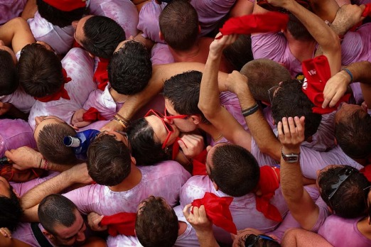 A couple kiss during the launch of the 'Chupinazo' rocket, to celebrate the official opening of the 2014 San Fermin ...