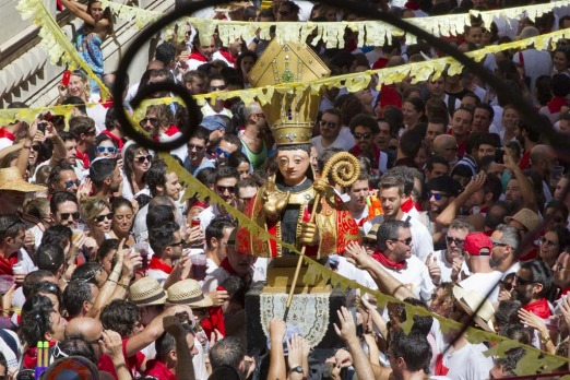 Revellers carry an effigy of San Fermin during a festival in Palma de Mallorca on the eve of the San Fermin Festival. ...