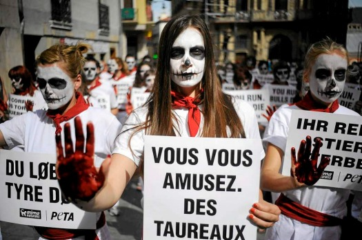 Activists of the People for the Ethical Treatment of Animals (PETA) and Anima Naturalis pro-animal groups, with skulls ...