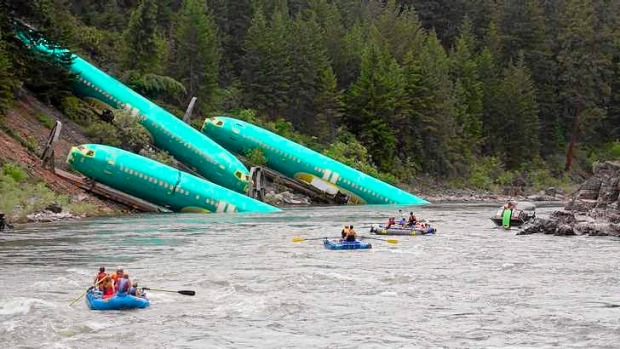 Three Boeing 737 fuselages lie on an embankment after a BNSF Railway train derailed near Rivulet, Montana.
