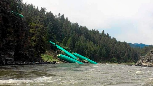 Boeing 737 fuselages lie on the embankment.
