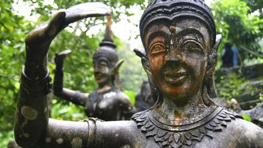 Carved peace: Stone statue in the magic garden at Ko Samui, Thailand.