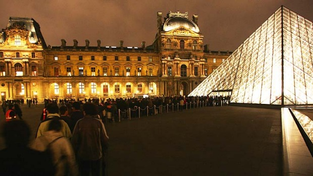 Night tour: A queue outside the Louvre museum in Paris.