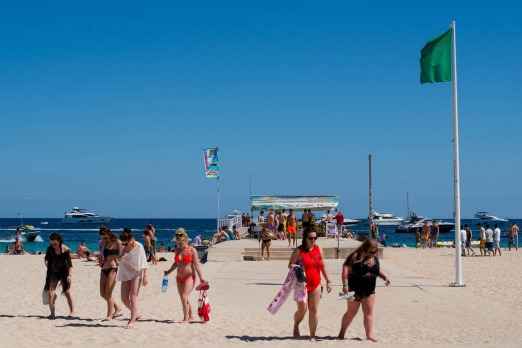 Tourist walk on at Magaluf beach in Mallorca, Spain.