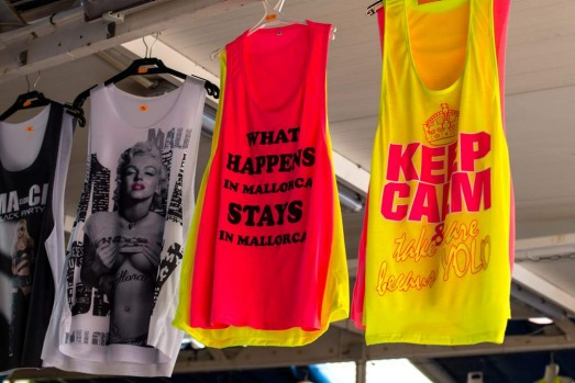 Shirts are seen on display at a Souvenir store at Magaluf beach in Mallorca, Spain.