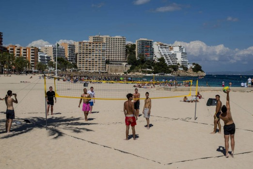 Tourists play beach-volley at Magaluf beach in Mallorca, Spain.