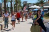 A tourist walks on the promenade at Magaluf beach in Mallorca, Spain.