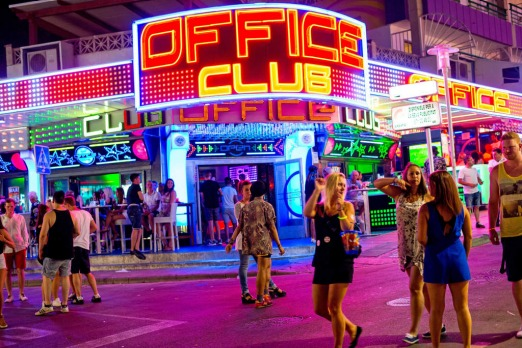 Tourists are seen enjoying the atmosphere of Punta Ballena Street, also known as 'the strip' in Mallorca, Spain.