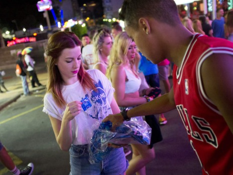 A girl distributes condoms to tourists in Punta Ballena street in the Magalluf zone, in Calvia on Mallorca Island.
