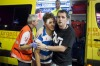 A young British tourist reacts after being treated by a member of medical services in Punta Ballena street in the ...