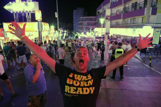 A tourist reacts at Punta Ballena street in Magaluf, on the Spanish Balearic island of Mallorca.