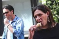 Tourists eat ice creams in Rome, Italy.