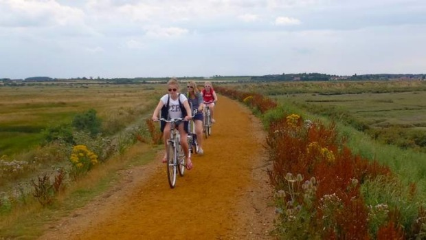Cycling on the Norfolk Coastal Path.