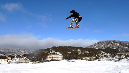 Safety first: A snowboarder gets some air over a jump.