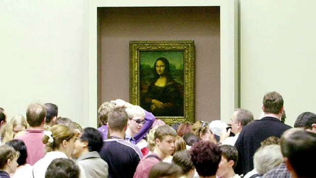 Crowded: Visitors are packed around the Mona Lisa.