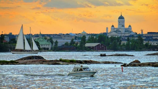 Sunset over Helsinki cathedral and the harbour.