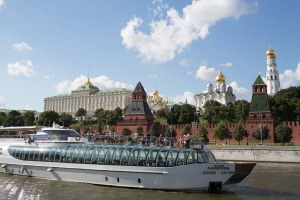 A tourist boat passes the Kremlin buildings as it sails along the Moskva river in Moscow, Russia.