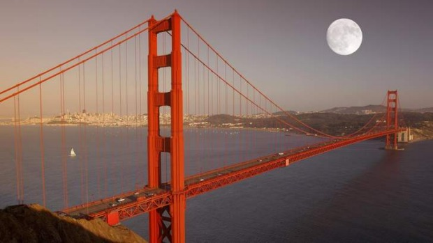 Breathtaking: Full moon over Golden Gate Bridge, San Francisco.
