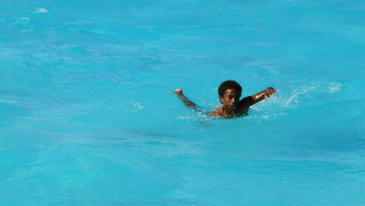 A Kanak boy cools off in New Caledonia.