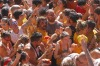 "Crowds of people throw tomatoes at each other, during the annual ""tomatina"" tomato fight fiesta, in the village of ..."