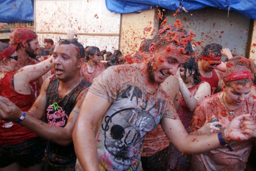 "People throw tomatoes at each other, during the annual ""tomatina"" tomato fight fiesta in the village of Bunol, 50 km ..."