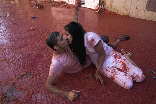 "A couple kisses during the annual ""tomatina"" festivities in the village of Bunol, near Valencia. Some 22,000 revellers ..."