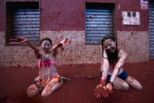"Revellers take part in the annual  ""tomatina"" festivities in the village of Bunol, near Valencia. Some 22,000 revellers ..."