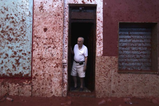 "A man stands in a doorway during the annual ""tomatina"" festivities in the village of Bunol, near Valencia. Some 22,000 ..."