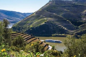 A Uniworld river cruise ship travels the Douro River in Portugal.