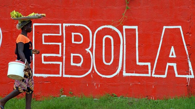 "A ""Ebola"" slogan painted on a wall in Monrovia, Liberia."