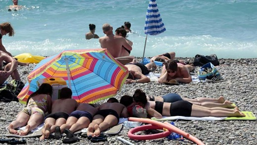 Warm summers: Tourists enjoy the sun on the beach in Nice, southeastern France.