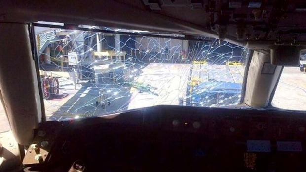 "Glenn Kagan posted this photo on his Facebook page with the caption: ""This is the shattered window from my sister's flight."""