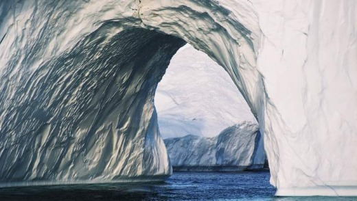 An iceberg tunnel in Greenland, where the effects of global warming are evident.