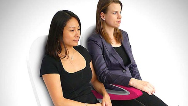 Paperclip armrest can reduce 'elbow room' spats.