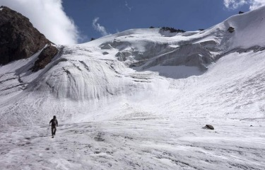 A tourist walks across the Manshuk Mametova glacier, about 3550 metres above sea level, in the mountains of Tien Shan outside Almaty, Kazakhstan.