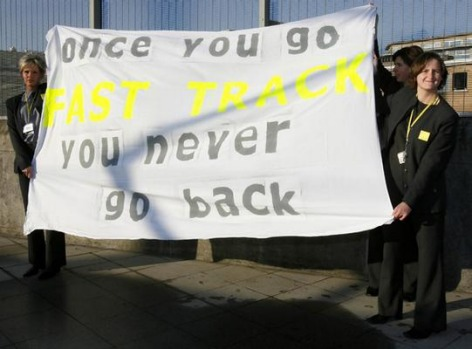 Eurostar staff hold a banner before the departure of the first Eurostar from Brussels' Midi station to London's St ...