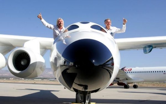 Virgin Galactic founder Sir Richard Branson, left, and Scaled Composites LLC founder Burt Rutan wave from the mothership ...