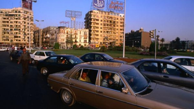 Cairo traffic is crazy ... but accepting help getting across may come with a price.