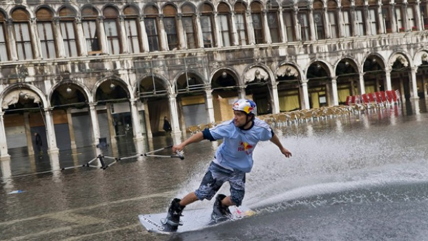 Duncan Zuur of the Netherlands rides on a wakeboard through a flooded St. Marks Square.