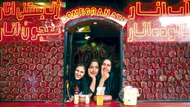 Young Isfahani women working in a pomegranate juice shop.