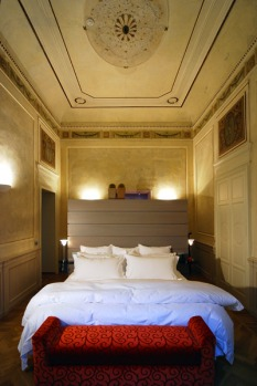 Add brilliantly coloured velvet furniture, sweeping satin curtains and a vast bathroom and you've got a room made for ...