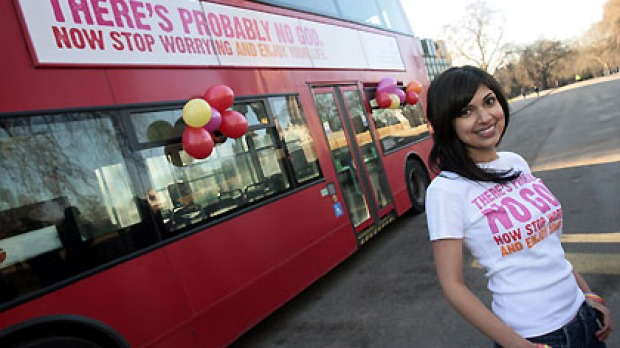 Comedy writer Ariane Sherine with one of the buses advertising that there's 'probably no God'.