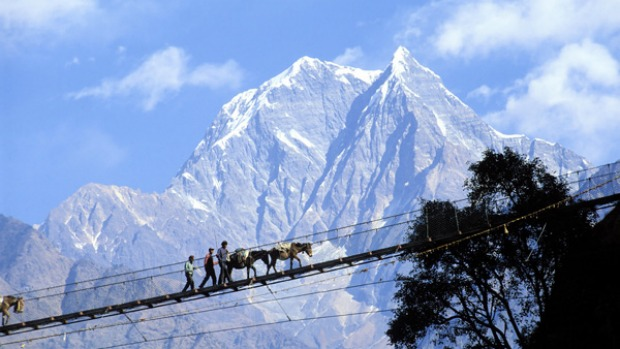 High way .... a suspension footbridge above the Kali Gandaki river.