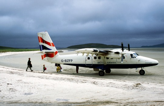 Barra Airport, Scotland. The airport on the tiny Outer Hebridean Island of Barra is actually a wide shallow bay onto ...