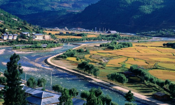 Paro Airport, Bhutan. Tucked into a tightly cropped valley and surrounded by 4900-metre-high Himalayan peaks, Bhutan's ...