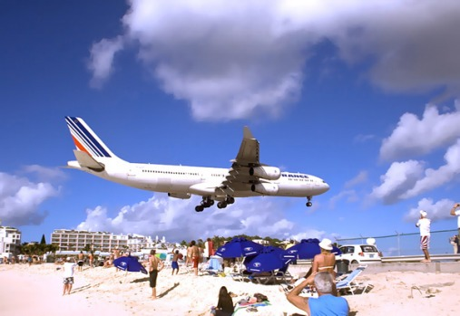 Princess Juliana International Airport, St. Maarten. It regularly welcomes wide-body jetliners like Boeing 747s and ...