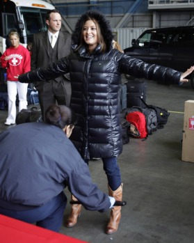 Australian singer and actor Holly Valance goes through security a the handover ceremony.