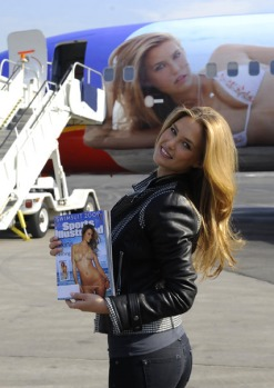 Israeli model Bar Refaeli poses in front of the Southwest Airlines jet bearing her image.