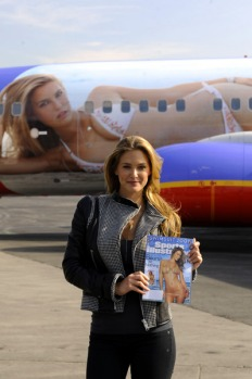 Bar Refaeli holds the 2009 cover of Sports Illustrated (SI) swimsuit issue, as she unveils SI One, a Southwest Airlines ...