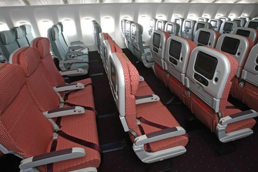 V Australia economy class ... the airline is attempting to wrestle away Qantas' long-held claim over the national identity.